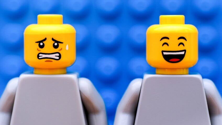 Two Lego minifigures - one scared and one happy.