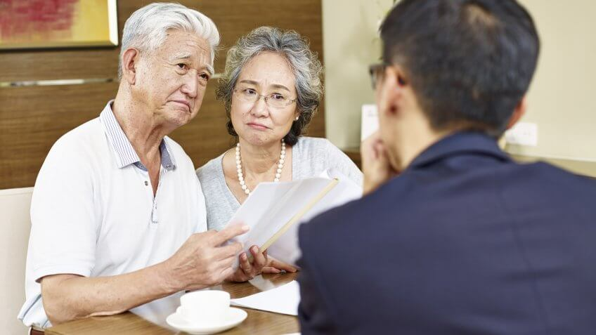 imtmphotoStock photo ID: 538648228senior asian couple looking skeptical during meeting with insurance agent.