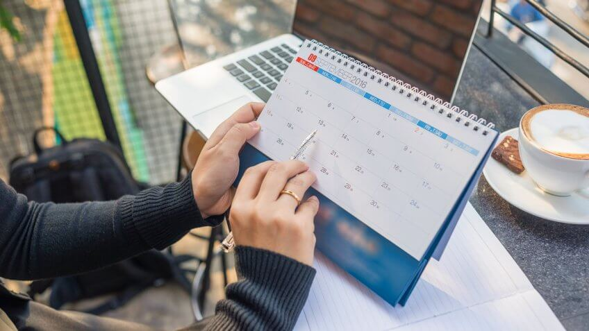woman pointing to date on calendar