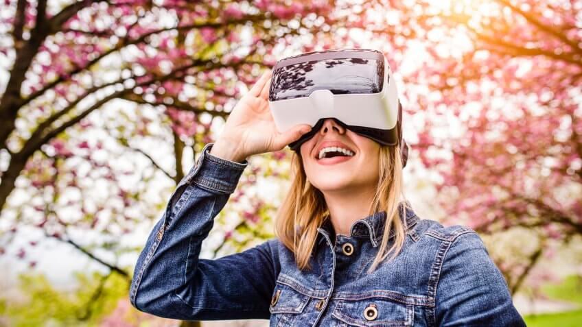 Woman wearing Magic Leap headset outdoors