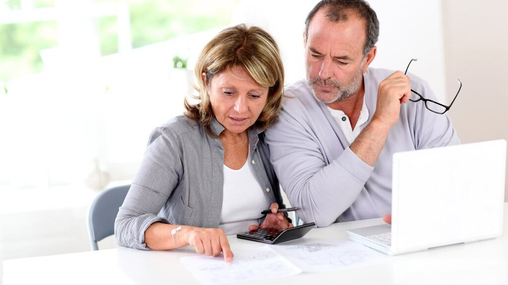 couple looking at financial statements