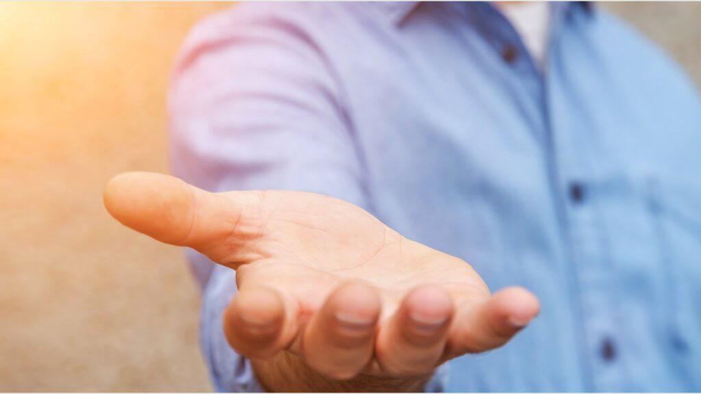 man extending hand to camera