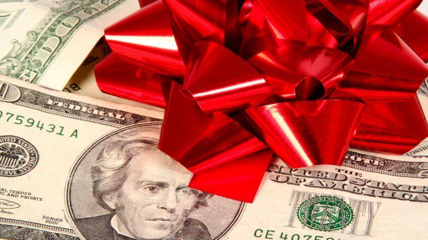 Christmas bow on money.