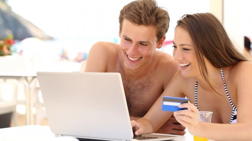 couple typing in credit card info
