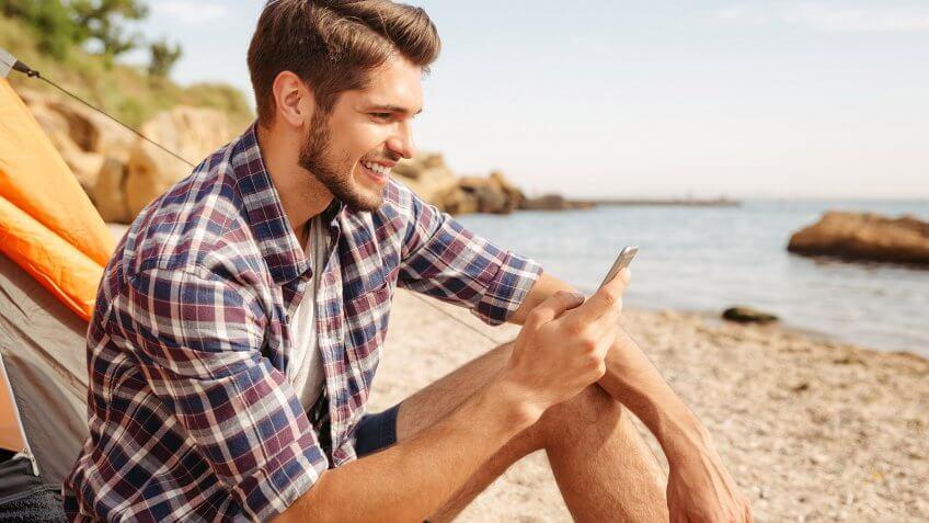 man on phone at the beach