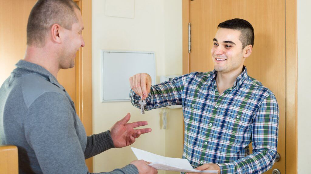landlord handing key over to tenant