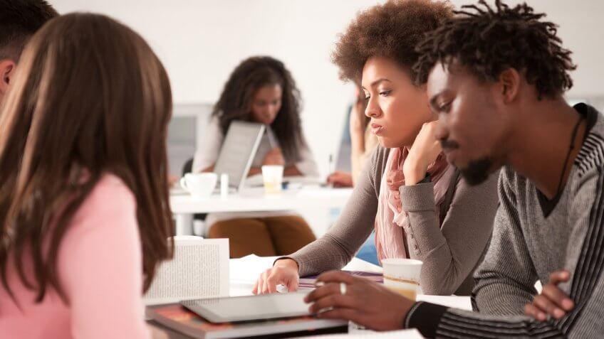 students sitting around looking despondent