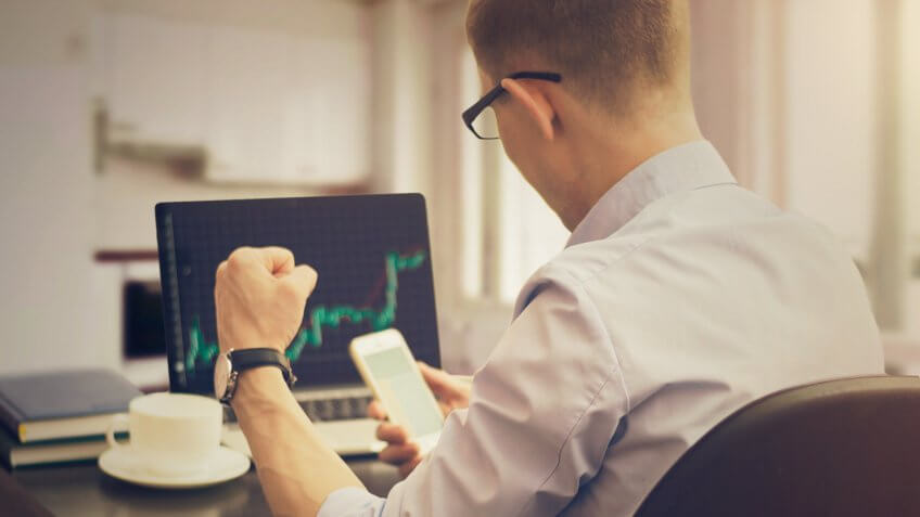 Businessman trader working in the office.
