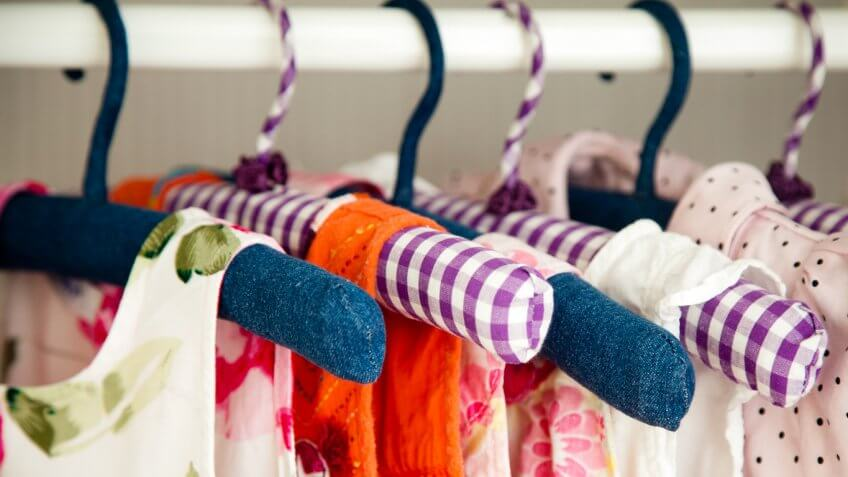 bright colorful dresses on clothes hangers