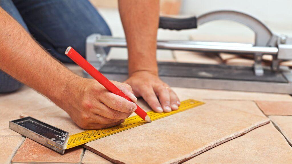 contractor making measurements on floor tile
