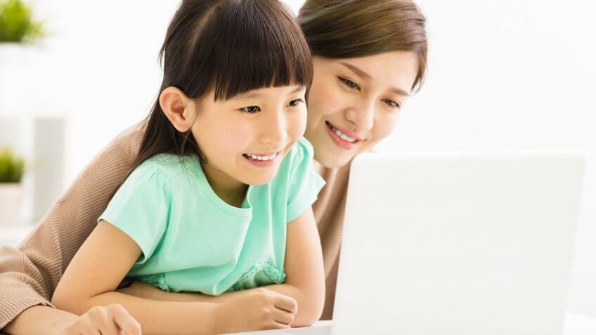 woman and child looking at laptop