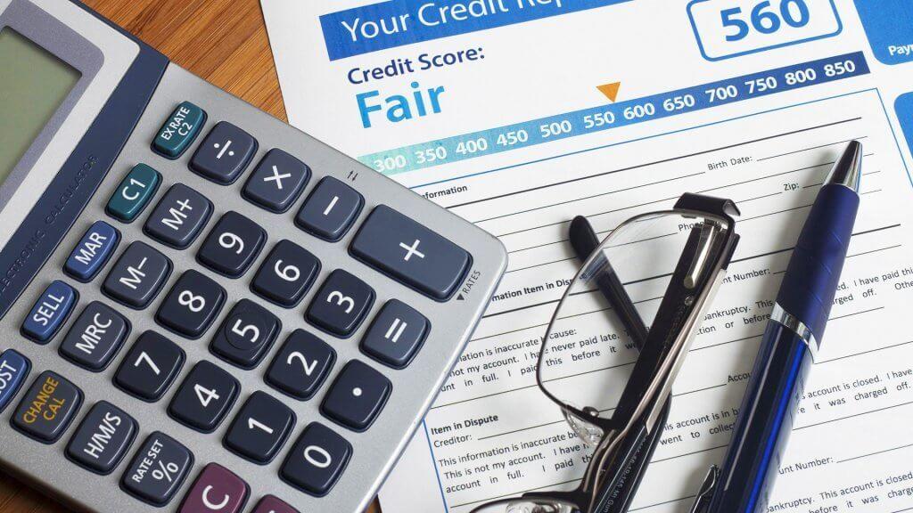fair credit report with calculator glasses pen