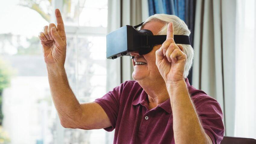 old man wearing vr headset and pointing up