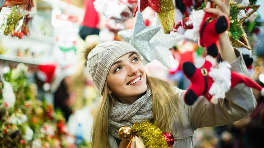 smiling woman under christmas decorations