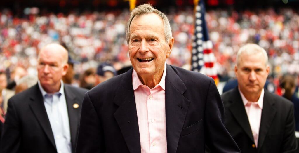 george h.w. bush at a football game
