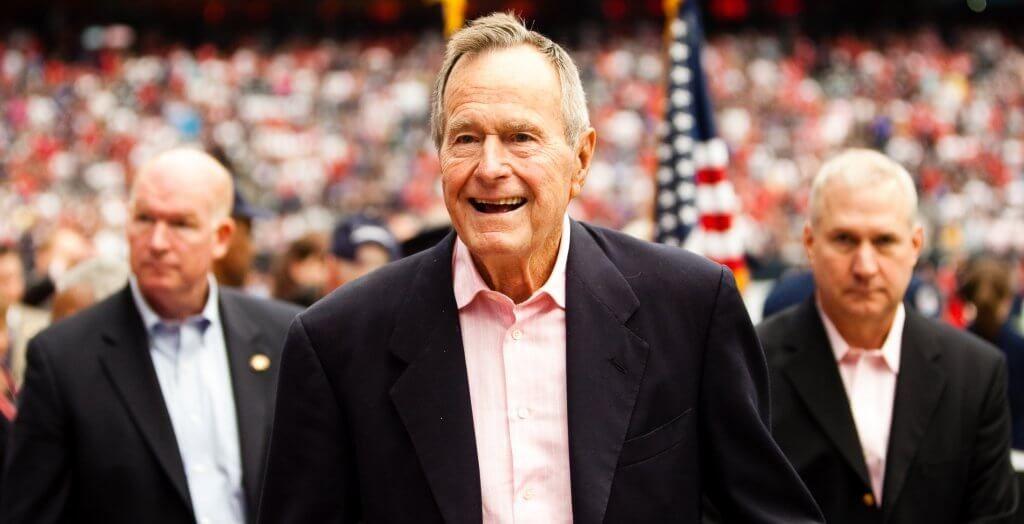 george h.w. bush at a football game