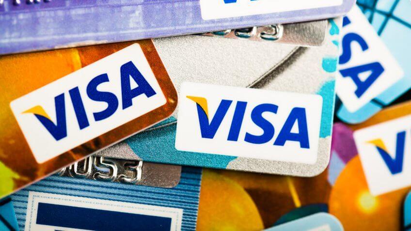 scattered stack of visa credit cards