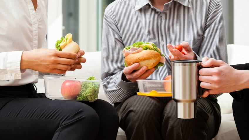 coworkers eating tupperware lunches together