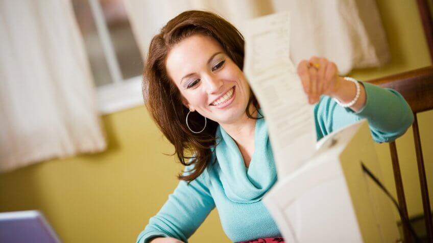 happy woman shredding a document