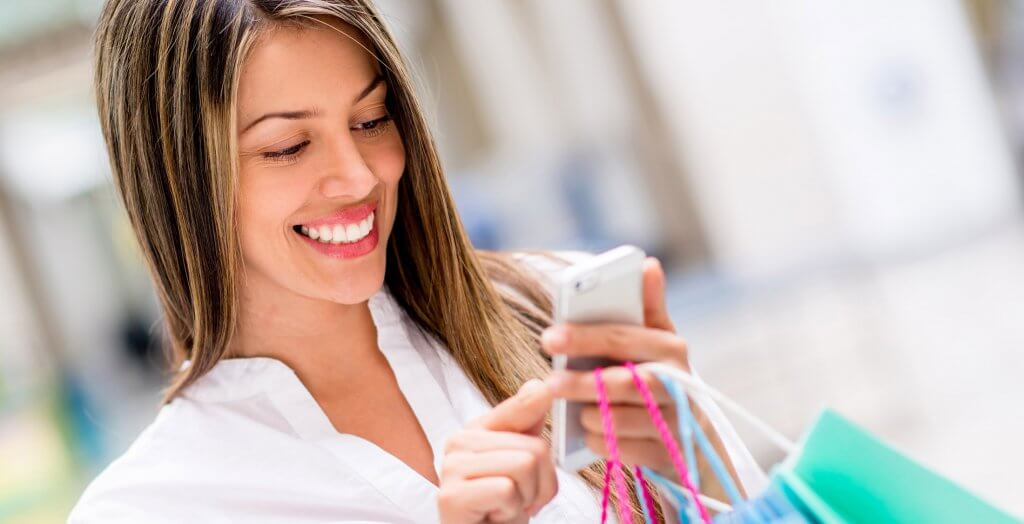 woman shopping and using phone