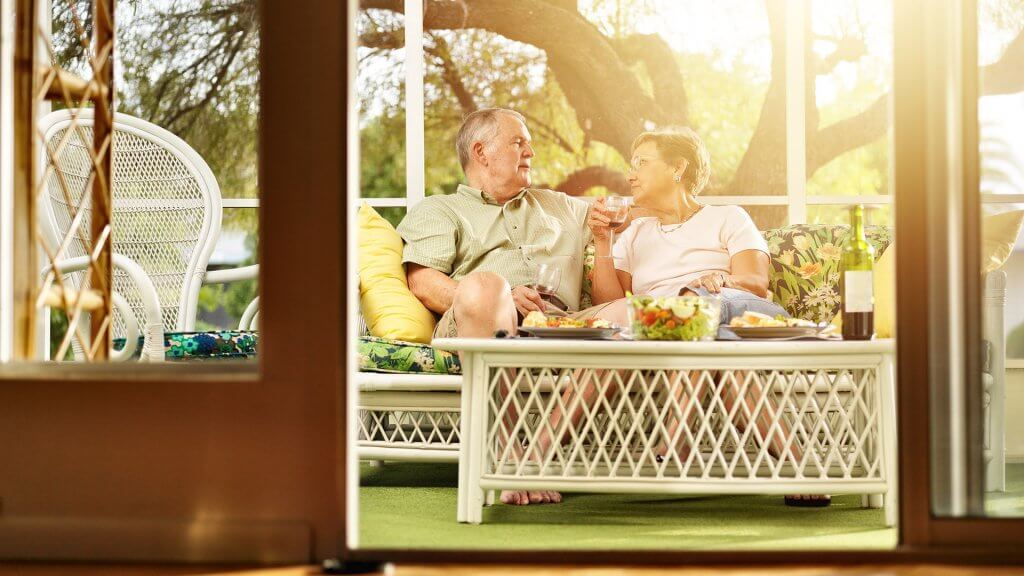retired couple relaxing at home