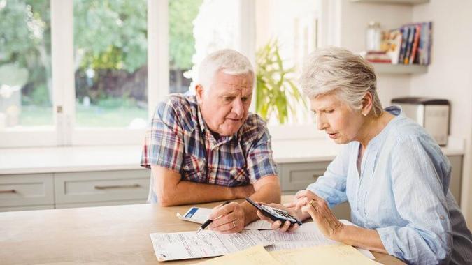 elderly couple working on finances