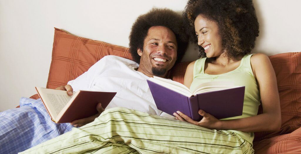 couple in bed reading books