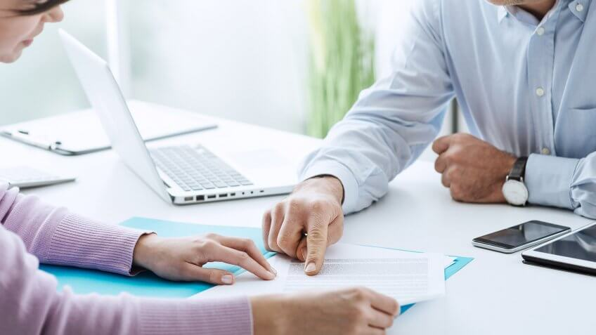hiring manager pointing to something on document