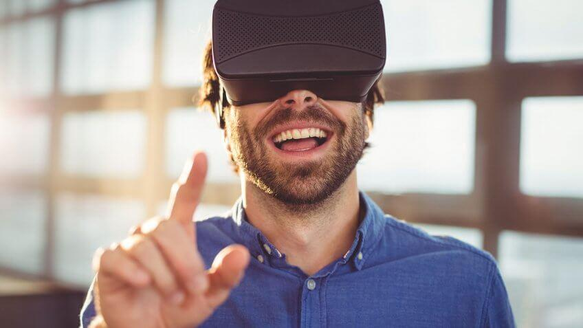 man with vr headset pointing