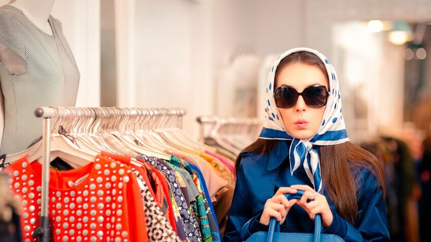 mysterious looking woman with head garb and sunglasses on inside store