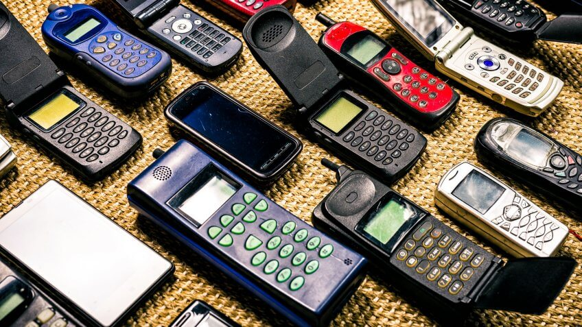 collection of old used mobile phones without logos and labels.