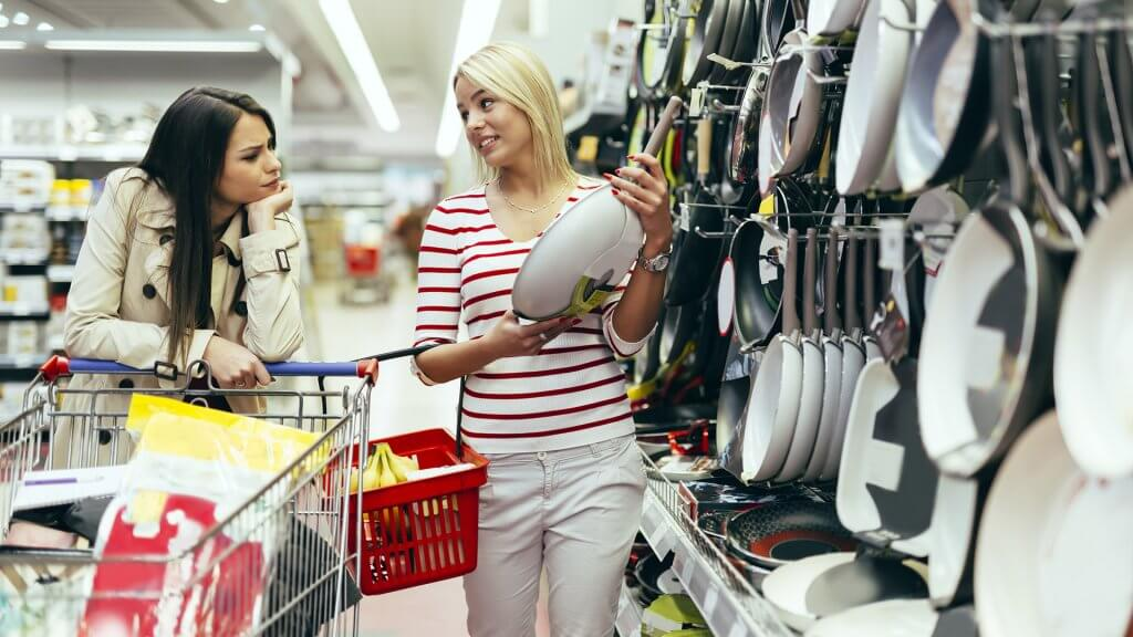 two women shopping for frying pans