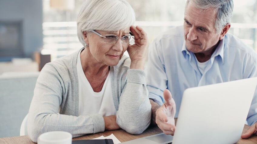 Shot of senior couple using a digital tablet at homehttp://195.