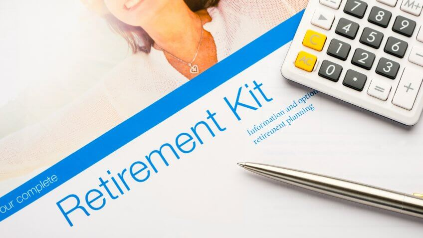 Retirement planning kit on a desk with paperwork.