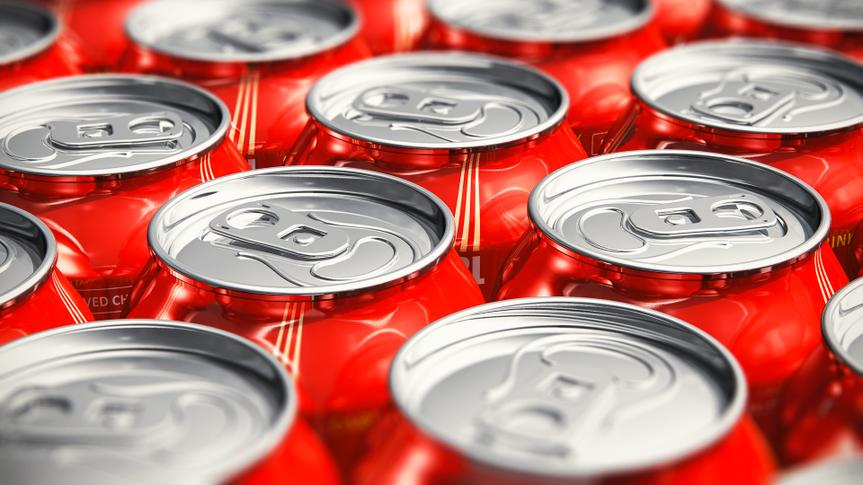 Macro view of color drink tin cans with cola soda beverage with selective focus effect.