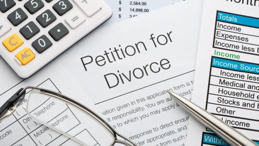 petition for divorce with pen and calculator.