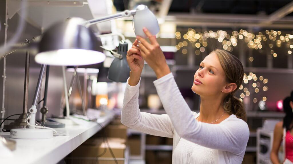 woman inspecting ikea lamp