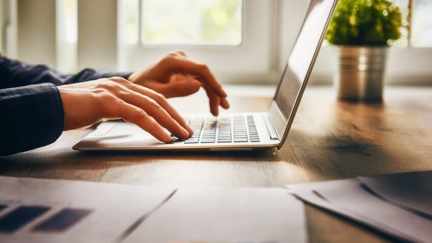businessman using laptop computer sitting working office.