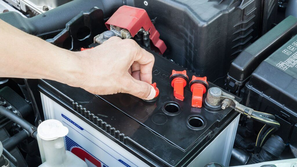 person checking car battery