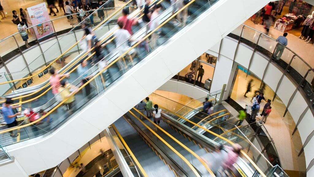 shot of escalators inside a busy mall
