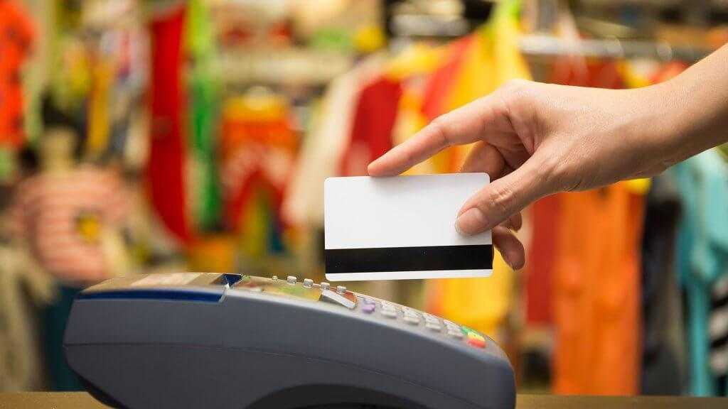 person swiping credit card
