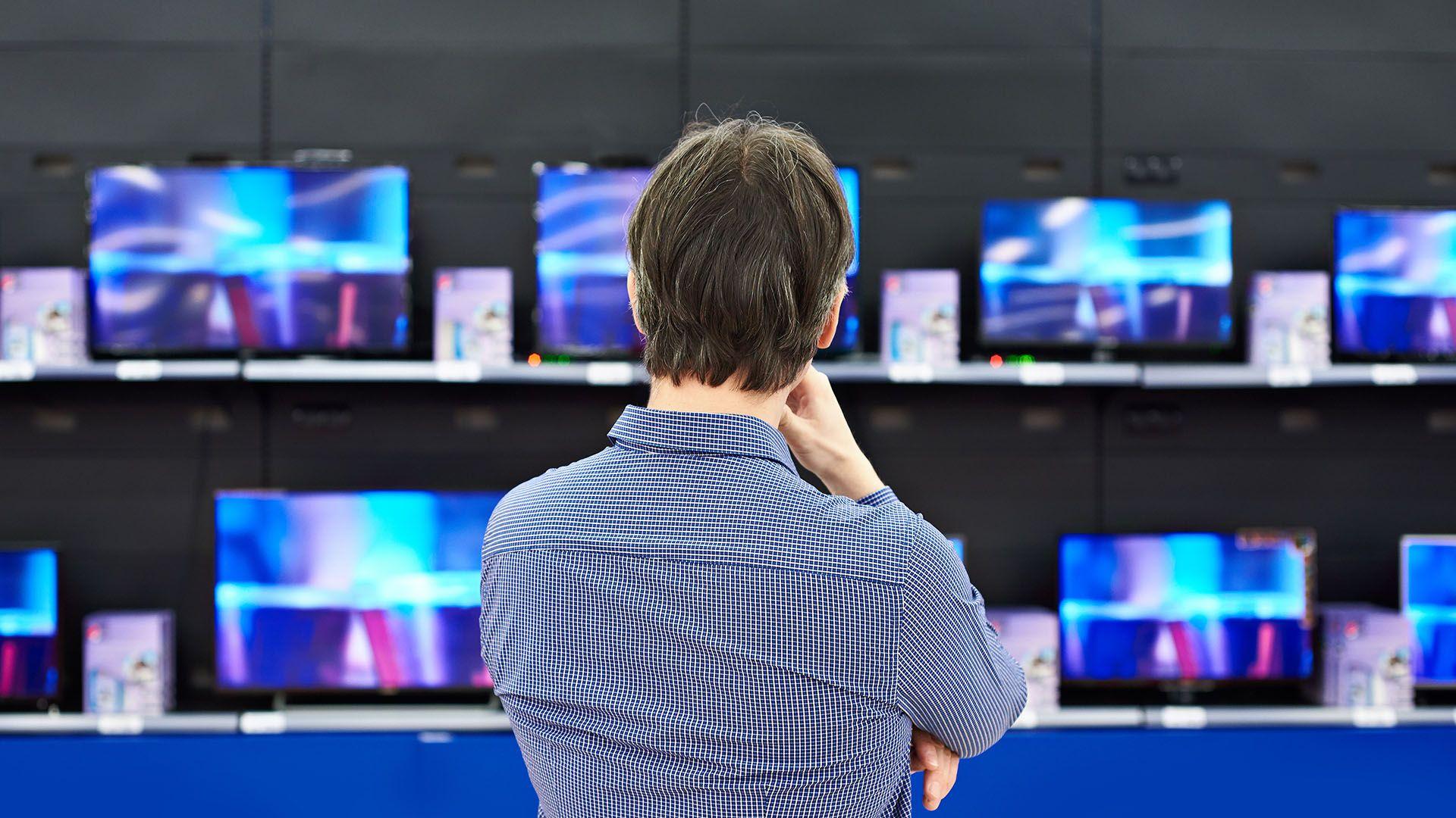 man shopping for TVs
