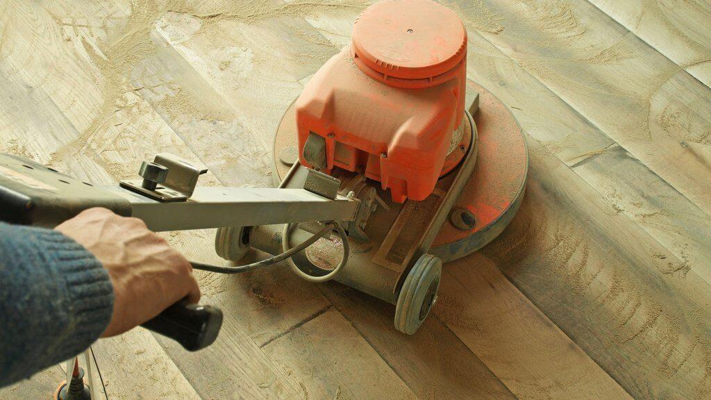 person operating floor sander