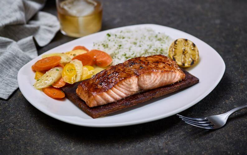 salmon filet with rice pilaf and vegetables