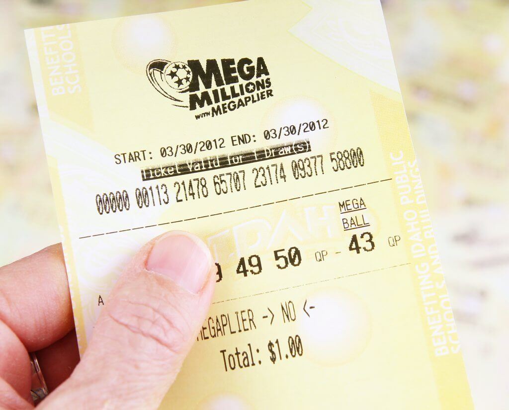 person holding lottery ticket