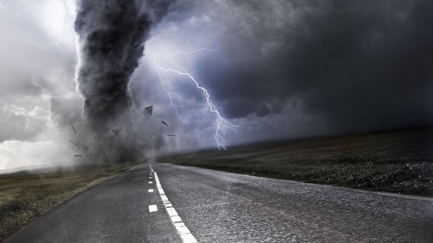 tornado destroying a home/farm in a rural area