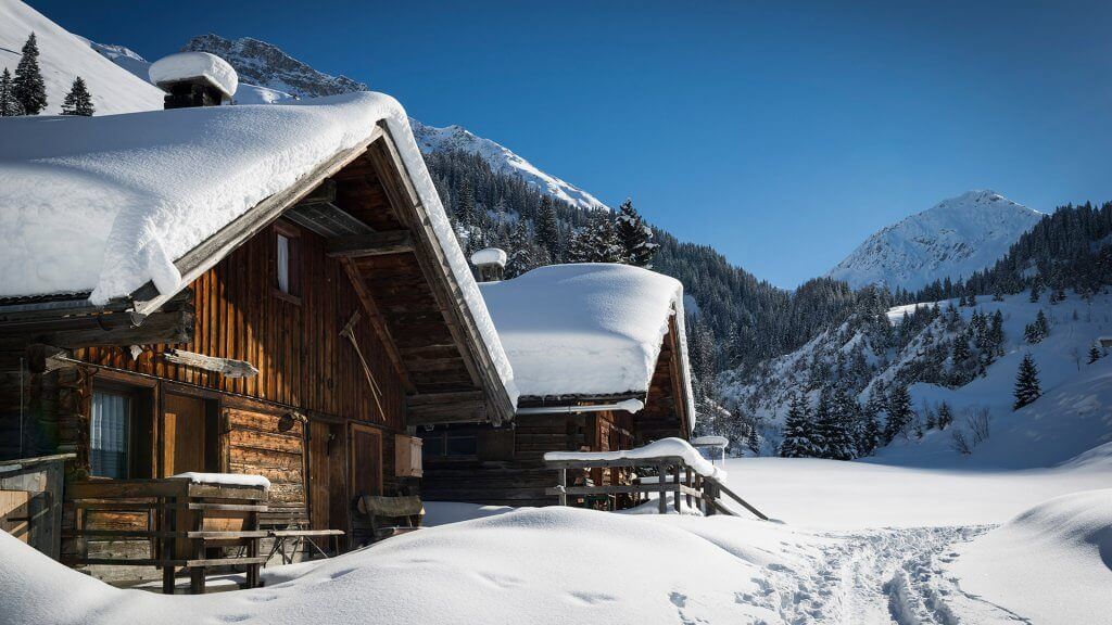 snow covered cabin in the mountains