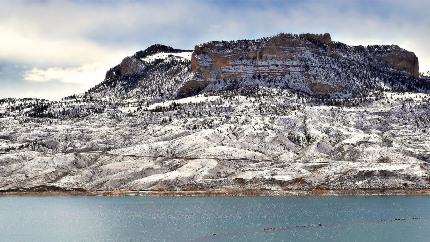 a lonesome fisherman on bufallo bill reservoir, just outside of cody, wyoming.