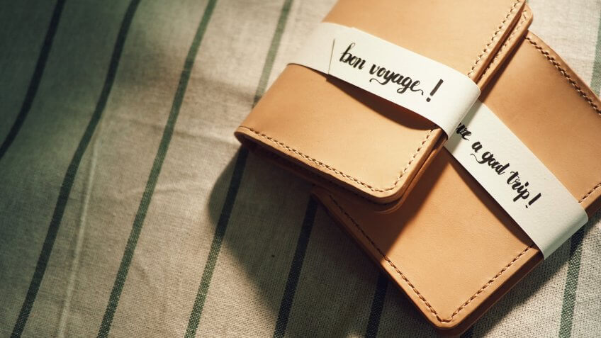 the hand crafted passport leather case with the tag 'bon voyage','have a good trip'.