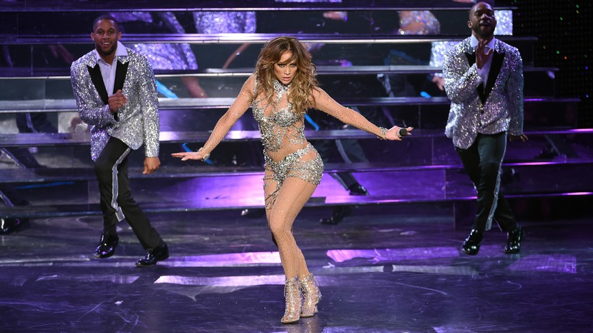 "LAS VEGAS, NV - JANUARY 20:  Singer/actress Jennifer Lopez (C) performs with dancers during the launch of her residency ""JENNIFER LOPEZ: ALL I HAVE"" at The Axis at Planet Hollywood Resort & Casino on January 20, 2016 in  Las Vegas, Nevada."